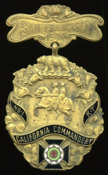 SAN FRANCISCO -- Knights Templar<br /> <br /> Lot 384  Hanger: SAN FRANCISCO / 1904 // (pin); badge: (bear) / (two knights on horse) / NO 1 / KT / CALIFORNIA COMMANDARY / (emblem) // (incuse: Shreve & Co. / San Francisco / Makers), (San Francisco CA), blue/green/red enamel on bz irr ov 36x42mm; overall 36x60mm.    G5-($16-$32)  Sold as part of group lot 405 $555.00