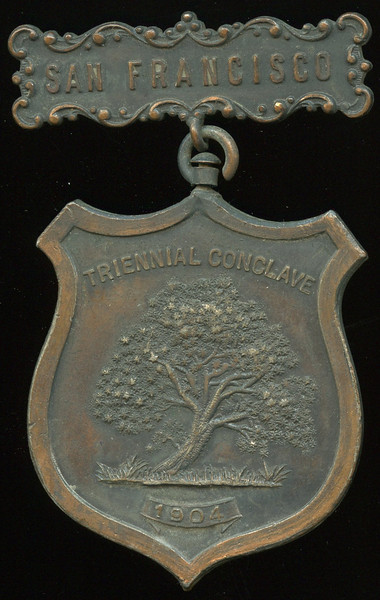 SAN FRANCISCO -- Knights Templar<br /> <br /> Lot 383  Hanger: SAN FRANCISCO // (pin) / Newark, N.J.; badge: DEO ET VERITATE / (emblem) / NO. 11 OAKLAND KT // Triennial Conclave / (tree) / 1904, (CA), bz shield 43x51mm; overall 75x46mm.      G5-($16-$32)  Sold as part of group lot 405 $555.00