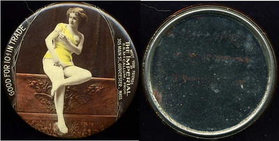 M064  SOLD!  GOOD FOR 10¢ IN TRADE / (lady seated with breast exposed – Dunn type 41) / MEET YOUR FRIENDS / AT / THE IMPERIAL / E.B. MCCALLUMM PROP. / 305 MAIN ST.,  GLOUCESTER, MASS. // edge imprinted: CRUVER MFG. CO. CHICAGO H.P.P., multicolored celluloid rd 56mm.  Mirror: scattered dark specks; celluloid: very light rubbing.    G4-EV9