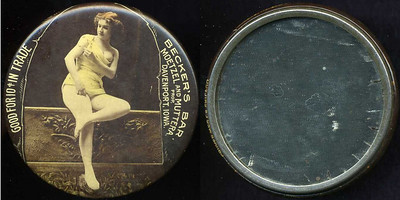 M052  SOLD!  GOOD FOR 10¢ IN TRADE / (lady seated with breast exposed – Dunn type 41) / BECKER'S BAR. / MOETZEL AND MUTTERA / PROP. / DAVENPORT, IOWA. // edge imprinted: CRUVER MFG. CO. CHICAGO, multicolored celluloid rd 56mm.  Mirror: short radial dark streaks around circumference; celluloid: moderate rubbing.    G3-EV9