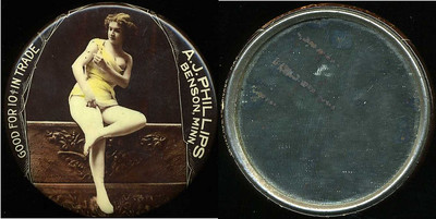 M072  SOLD!  GOOD FOR 10¢ IN TRADE / (lady seated with breast exposed – Dunn type 41) / A.J. PHILLIPS / BENSON, MINN. // edge imprinted: CRUVER MFG. CO. CHICAGO H.P.P., multicolored celluloid rd 56mm.  Mirror: scattered dark specks; celluloid: very light rubbing.    G4-EV9