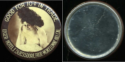 M022  SOLD!  GOOD FOR 10¢ IN TRADE / (woman with feathery hat – Dunn type 21) / LEGER HOTEL, F. SUESSDORF, PROP. MOKELUMNE HILL, CAL. // edge imprinted: CRUVER MFG. CO, CHICAGO., multicolored celluloid rd 56mm.  Mirror: clean; celluloid: minimal rubbing.  Unlisted design for CA-M45-L5.    G3-EV11