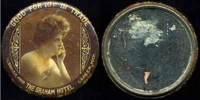 M070  GOOD FOR 10¢ IN TRADE / (woman with hand on chin – Dunn type 34) / J.J. GRAHAM, PROP.  THE GRAHAM HOTEL  LAPEER, MICH. // edge not imprinted, multicolored celluloid rd 56mm.  Mirror: considerable damage to silvering; celluloid: gouge, scratches.      G2-EV8
