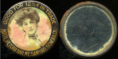 M031  SOLD!  GOOD FOR 12½¢ IN TRADE / (Evelyn Nesbitt facing – Dunn type 12) / HOTEL VICTORIA BAR, M.E. SANFORD, SONORA, CAL., edge not imprinted, multicolored celluloid rd 56mm.  Mirror: numerous scattered black specks; celluloid: light scratches, considerable foxing.  CA-S60-H5B URS-1.   G2-EV10