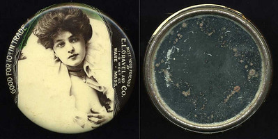 M067  GOOD FOR 10¢ IN TRADE / (Evelyn Nesbitt facing – Dunn type 12) / MEET YOUR FRIENDS / AT / E.L. GRAVELAND AND CO. / 1 – 3 WEST ST. WARE, MASS. // edge not imprinted, multicolored celluloid rd 51mm.  Mirror: scattered brownish spots; celluloid: tiny digs.    G4-EV9