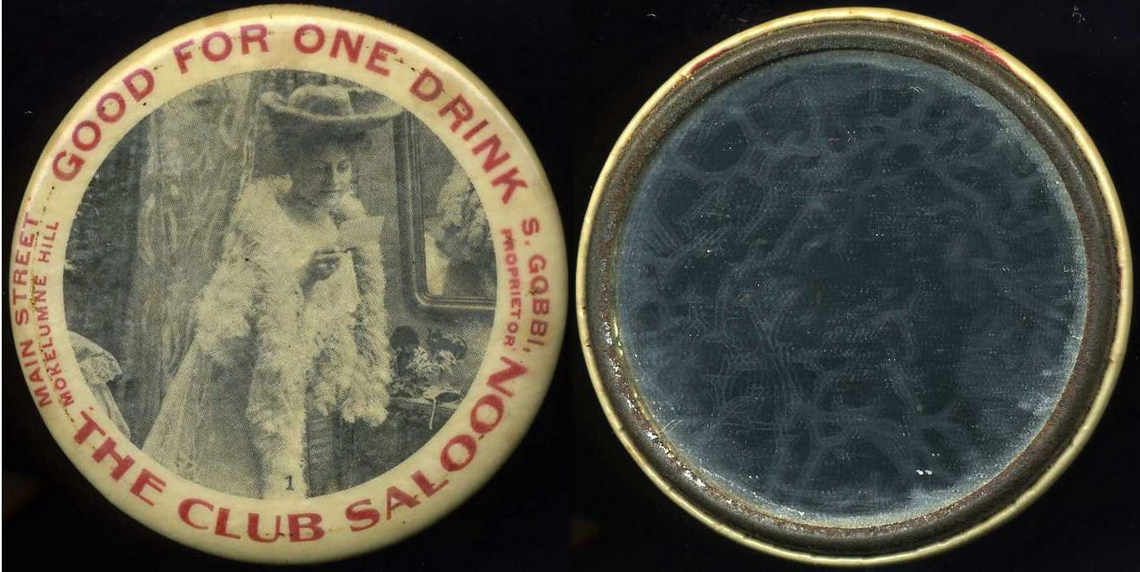 M009  SOLD!  GOOD FOR ONE DRINK / (to left: MAIN STREET / MOKELUMNE HILL) / (woman with feather scarf – Dunn type 95,  imprint: 1) (to right: S. GOBBI / PROPRIETOR.) / THE CLUB SALOON // edge imprinted: JORDAN PTG CO., OAKLAND, CAL., multicolored celluloid rd 56mm.  Mirror: clean; celluloid: light scratches.  CA-M45-C5A URS-3.    G3-EV9