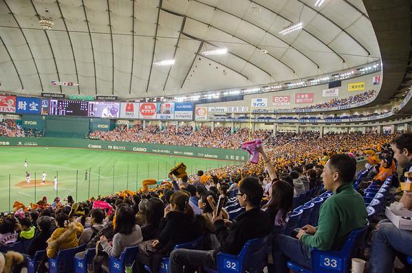 Watching a Japanese baseball game at the Tokyo Dome.