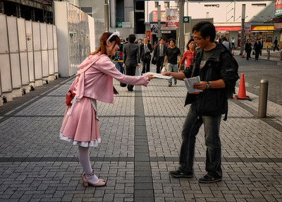 Akihabara, passing out coupons for a Cos Play Cafe