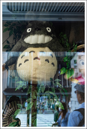 A giant Totoro in a shop window.