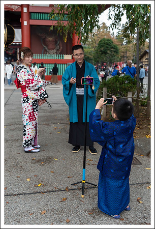 There were many many Chinese tourists all dressed up in kimonos.  The kimono patterns were often very unusual and something you would never see a Japanese person wear.  This family was speaking Chinese, and her kimono is very non traditional.