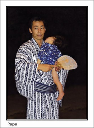 A father and his son at the Bon Odori summer fesival.