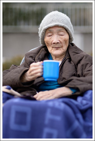 Seishi's mom drinking hot chocolate in the park.  She has a real sweet tooth