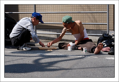 Two men setting up a chess board on the road in Sangenjaya.