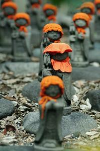 Jizo, little budahs that protect children.