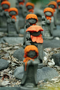 Jizo, little budahs that protect children.