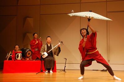 Senwaka performing Kasa-no-kyoku (spinning various objects around the top of an umbrella)