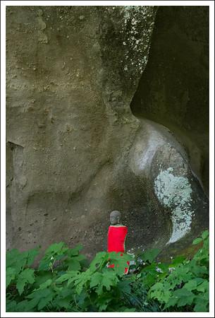 A little Buddha under a big rock