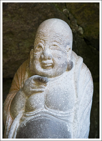 This is the god of happiness.  If you rub his finger and his tummy you will get happy.