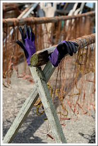 Purple gloves and orange fishing nets.