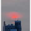 The sunset from our window, taken with a telephoto lens.
