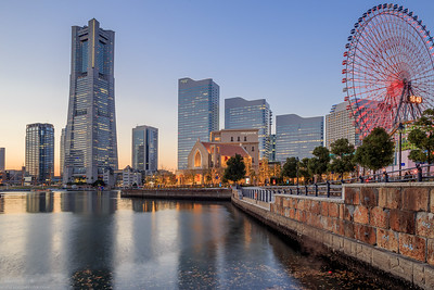At the waterfront of Minato Mirai facing the tower buildings. 16:40 the sun is fading away. A picture merged from 3 shots.