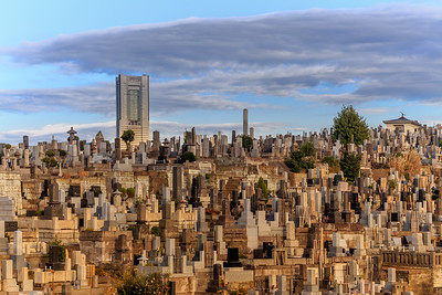 The Landmark tower surpassing the hill with the many graves. Tower of the living contrasting the towers of the dead.