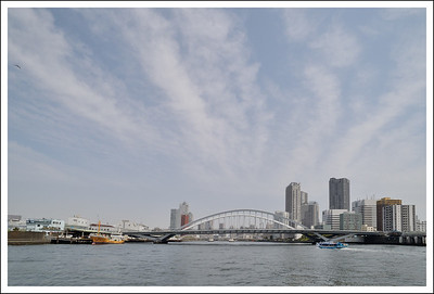 Tsukiji Bridge.  You can see the Tsukiji fish market on the left.  The yellow boat is a fishing trawler parked there.  The market extends on both sides of the bridge.