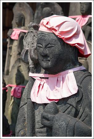 Jizo san with a faded bib