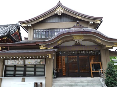 Asakusa Shinto Shrine and emblem representing the two fishermen who found the Image of the Bodhisatva, and the Abbot who respected it and saved the Image.