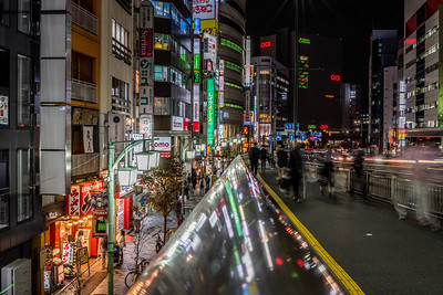 Shinjuku bridge walkway at night.