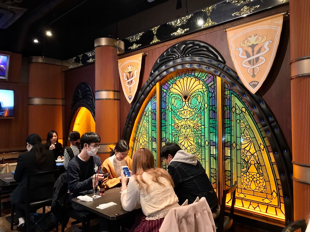 An ornate stained glass window in Eorzea Cafe.