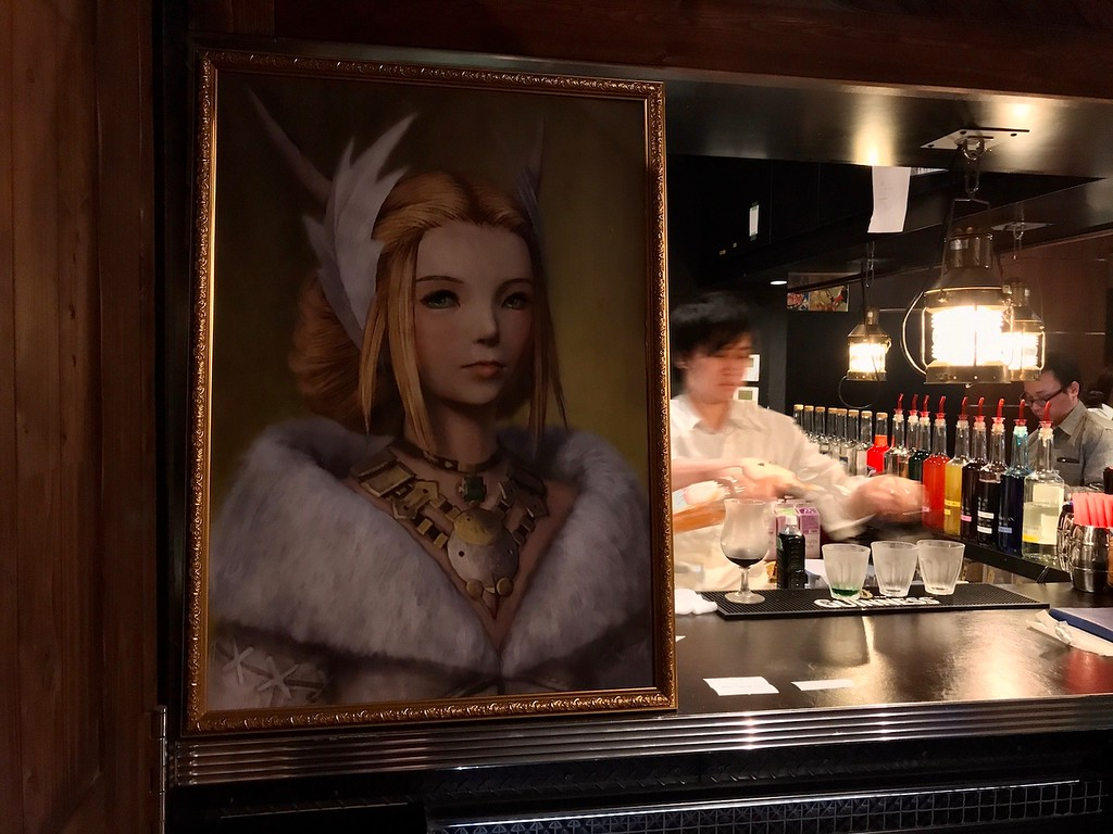 A painting hanging right next to the entrance of the cafe.