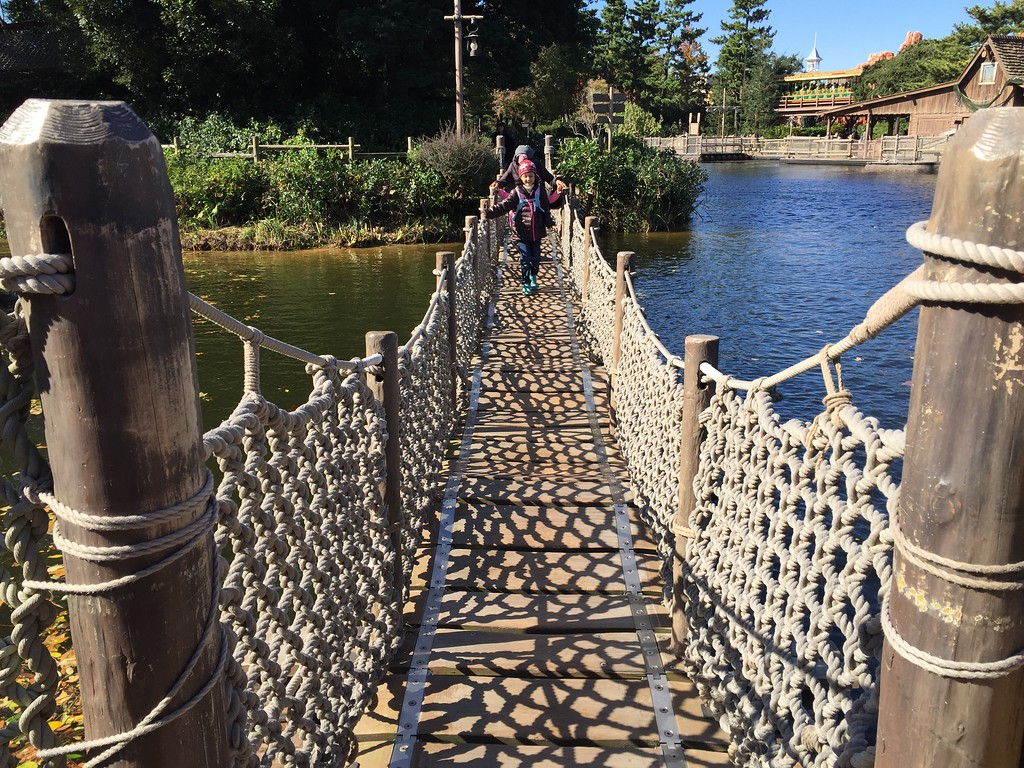 Crossing the rope bridge on Tom Sawyer Island