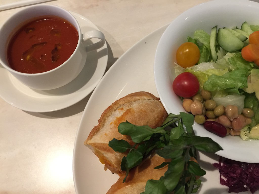 Vegetarian baguette sandwich, salad, and soup