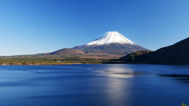 Mt Fuji rising over Lake Motsu. Editorial credit: Arata Matsumoto / Shutterstock.com