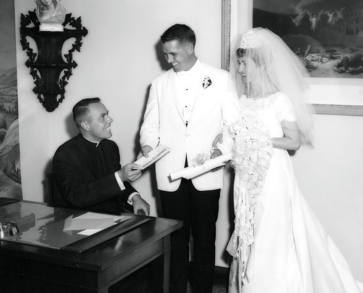 Lloyd giving Tom and Betty their marriage certificate