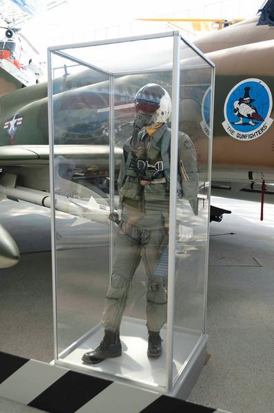 Nam Era Flight suit, survival vest, and G suit.  Wearing F-4 Martin Baker Seat harness (legstraps unfastened).