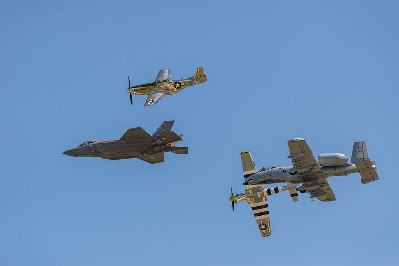 P-51's in the break for landing