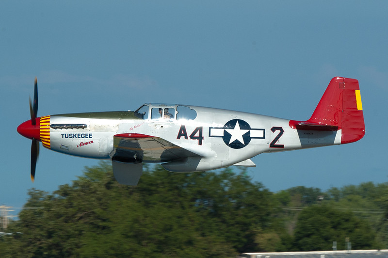 P-51A in the colors of the 332 Fighter Group, the Tuskegee Airmen.  Three surviving members were at the show and autographed their book for me.