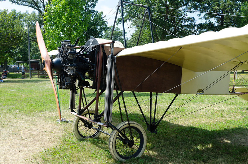 Replica of 1909 Louis Blériot aircraft that made the first crossing of the English Channel.  Roll control was by mechanical wing warp from control wheel to cables through the pivot point seen below the fuselage.