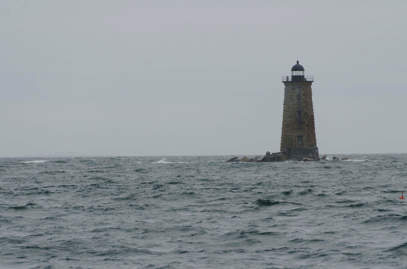 """At the entrance to Portsmouth, 1872 Whales Back Lighthouse which replaced original of 1830.  Even at 60 feet, Goldy reports waves topping it in the """"Perfect Storm"""" of Oct 1991.  It is often called the New Hampshire Lighthouse, though it is actually in Maine."""
