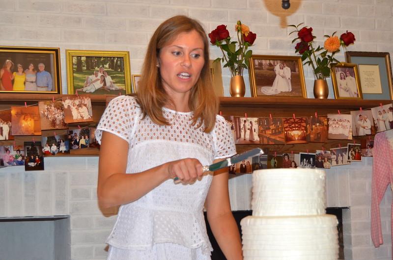Anne prepares to slice the cake