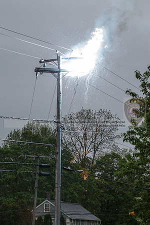 Arcing on the top of the pole with some burning debris falling