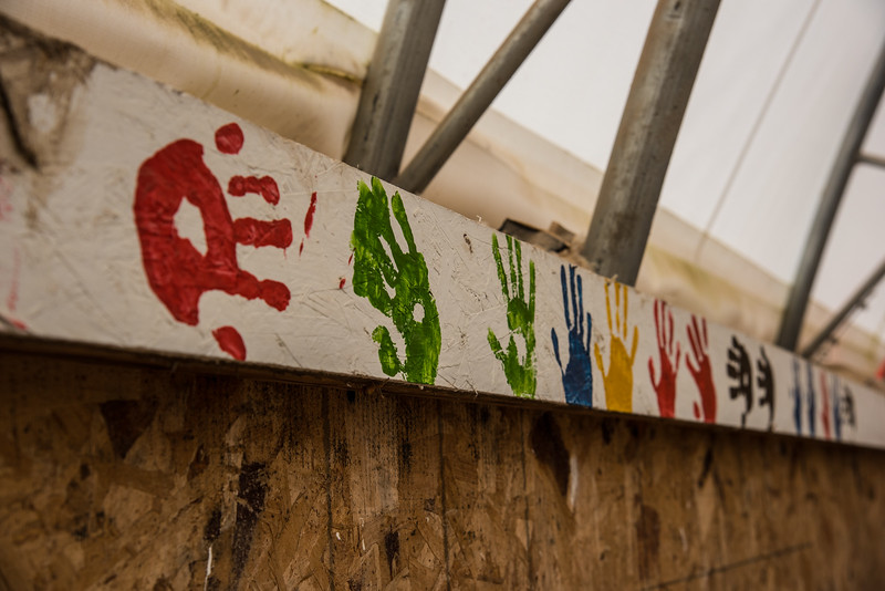 Children's handprints in a horse arena on Rosebud Reservation in South Dakota