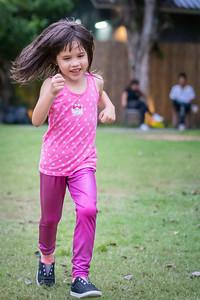 Aum running after frishbee