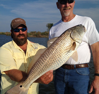 Red Fishing with Outcast Fishing Charters with Lloyd Landry 504-912-8291 Guests Frankie Logan and Philip Junkin