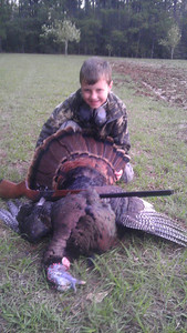 Wills first turkey at 8 years old.  mississippi opening day with his new 20 ga