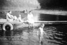 Swimming in the Susquehanna River in the Wilkes-Barre, PA area, circa 1958. Tom is in the water, Bill on the dock.