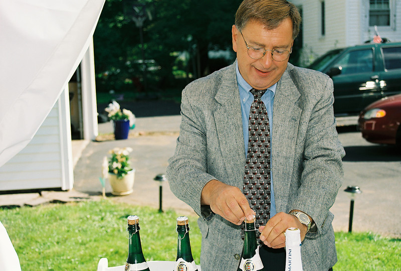 Frank is helping by opening the bubbly. 2004