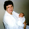 Grandma Ann & newly born Katie. 1985